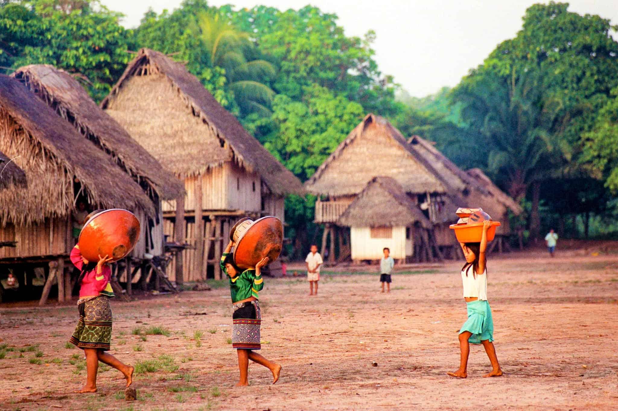Women carrying baskets in a village near the Cordillera Azul project. Photo © Nancy Stone.