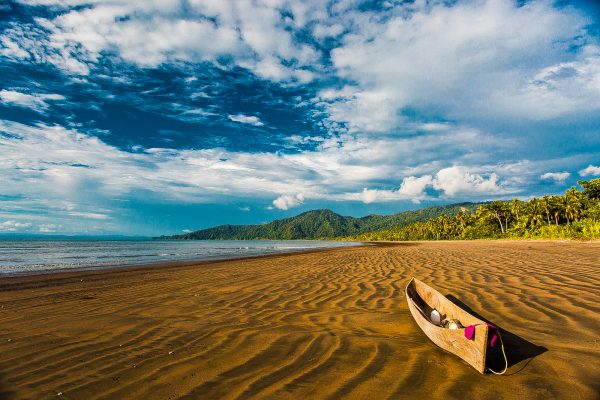 A canoe on the beach in the Pacific Forest Communities, Colombia.