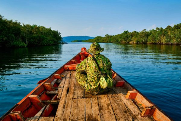 A ranger patrols by canoe in the Southern Cardamom project, Cambodia.