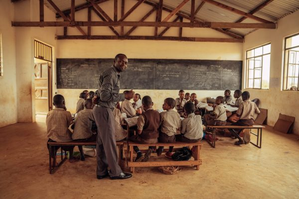 A class in session with desks and chairs provided by the Kasigau project, Kenya. Photo credit: Filip C. Agoo for Wildlife Works Carbon.