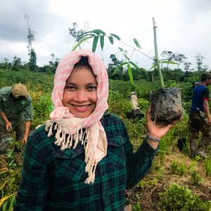 A young girl holds a tree sapling during tree planting operations in the Keo Seima project, Cambodia. (C) WCS.
