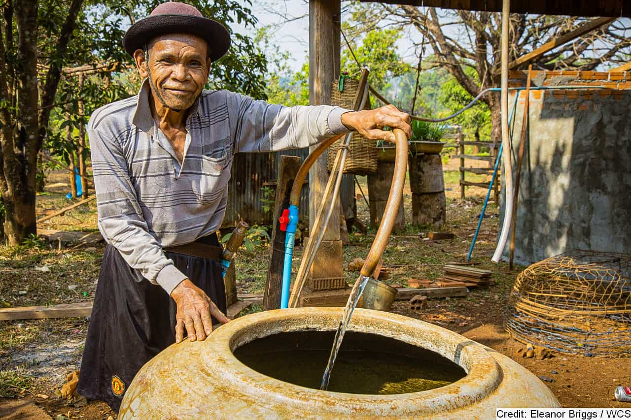 A member of the indigenous Bunung people fills a water pot near the Keo Seima Wildlife Sanctuary, Cambodia.
