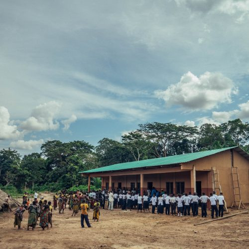 Children and visitors gathered outside a school in the Mai Ndombe project, DRC. Photo credit: Filip C. Agoo for Wildlife Works Carbon.